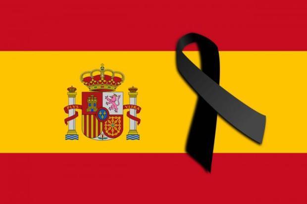 9721469472657-Bandera-de-Espana-con-un-lazo-negro.jpg